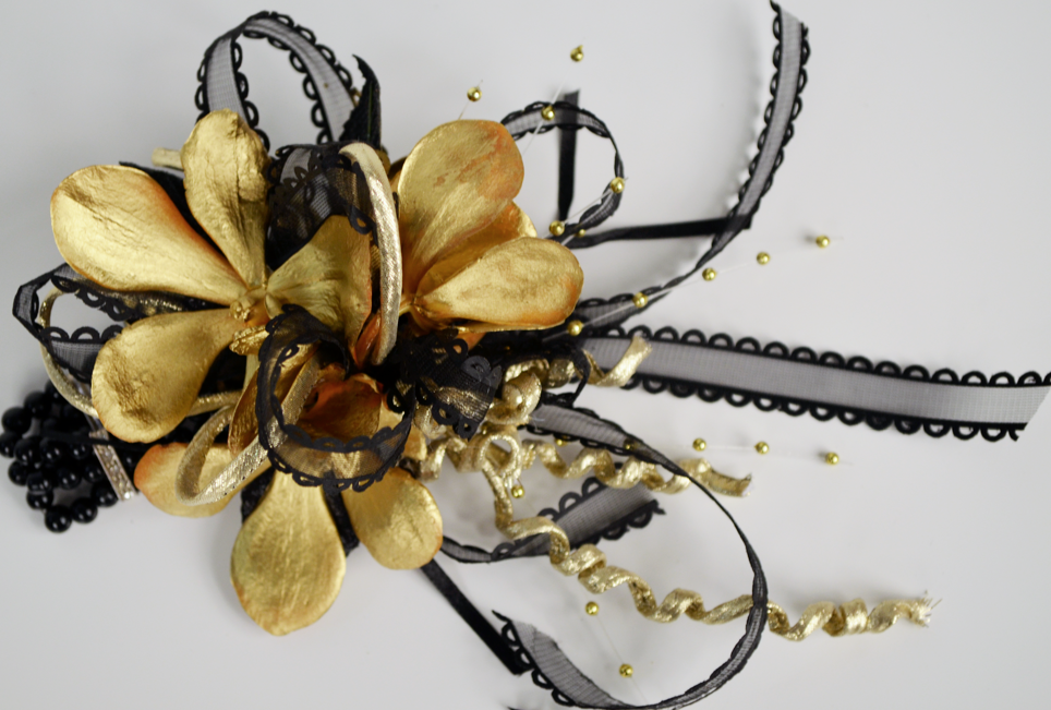 Gold and Black Orchid wrist corsage
