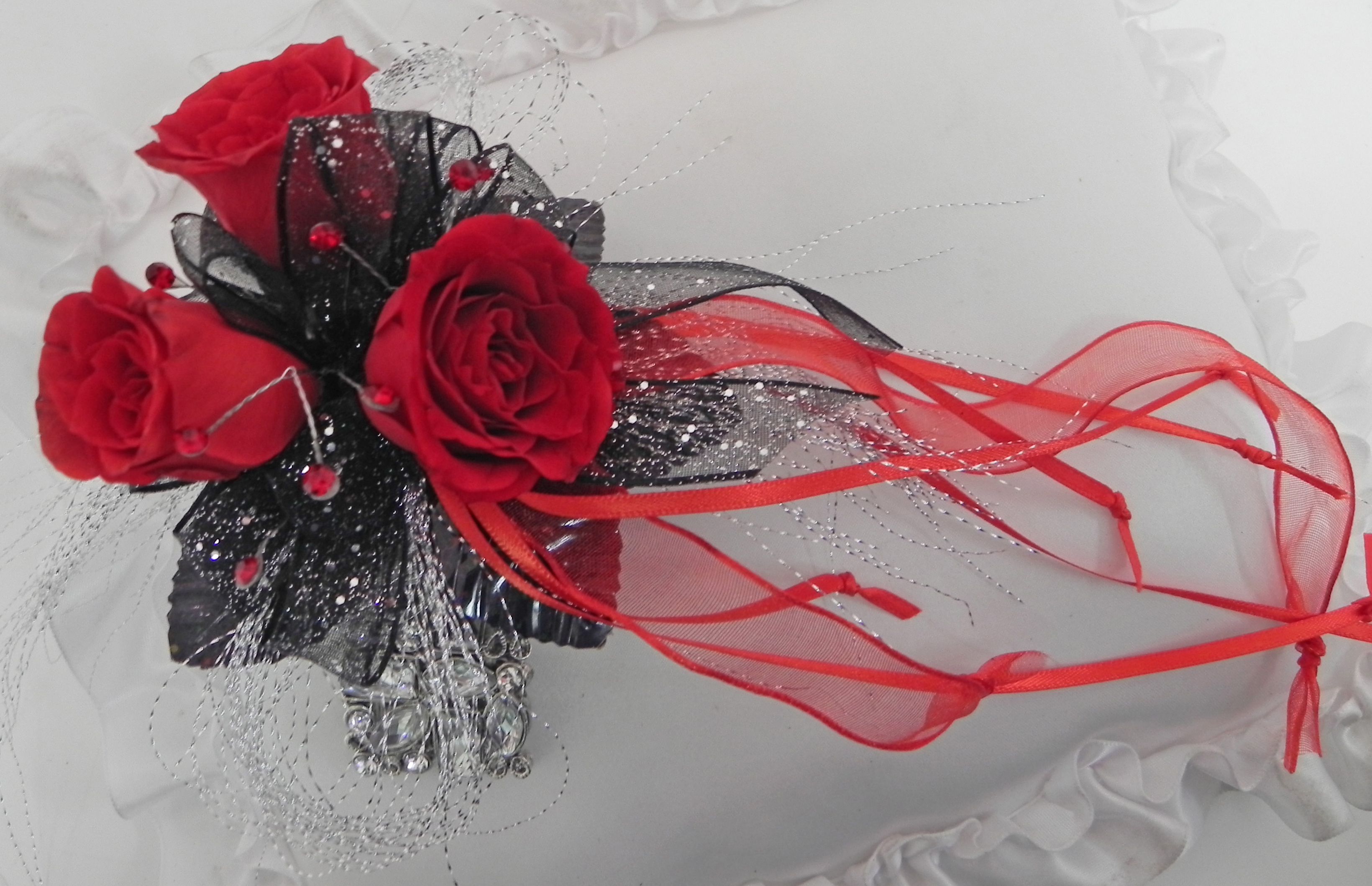 red and black glitter prom corsage